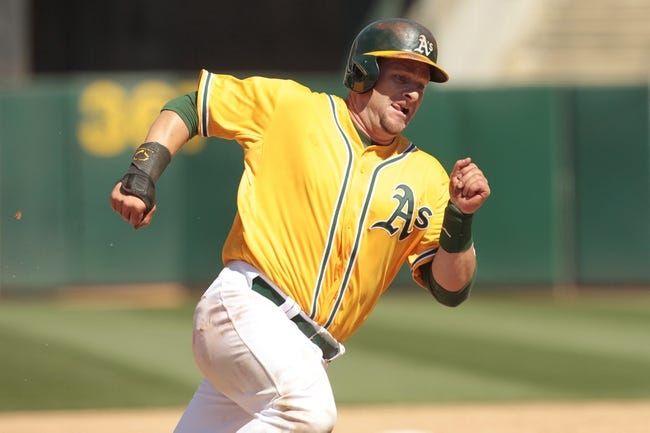 Jul 28, 2013; Oakland, CA, USA; Oakland Athletics catcher Stephen Vogt (21) runs towards home before scoring a run against the Los Angeles Angels in the sixth inning at O.co Coliseum. Mandatory Credit: Cary Edmondson-USA TODAY Sports
