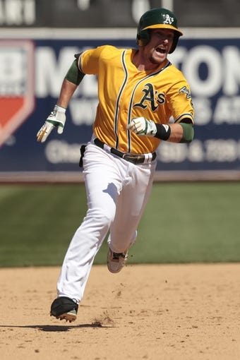 Jul 28, 2013; Oakland, CA, USA; Oakland Athletics infielder Jed Lowrie (8) runs towards third base against the Los Angeles Angels in the sixth inning at O.co Coliseum. Mandatory Credit: Cary Edmondson-USA TODAY Sports