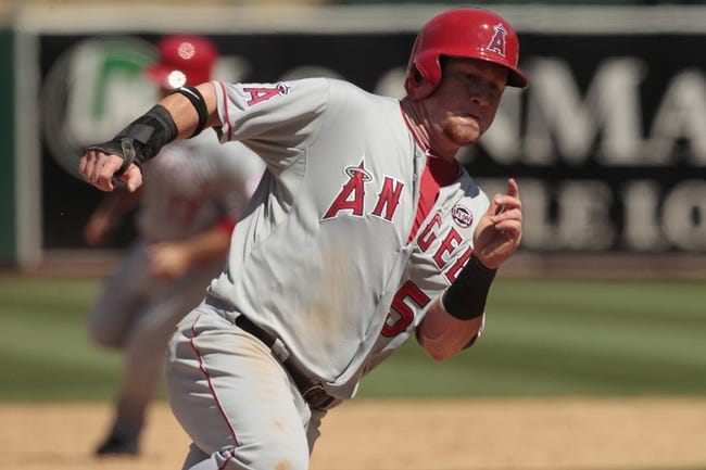 Jul 28, 2013; Oakland, CA, USA; Los Angeles Angels outfielder Kole Calhoun (56) rounds third base before scoring a run against the Oakland Athletics in the sixth inning at O.co Coliseum. Mandatory Credit: Cary Edmondson-USA TODAY Sports