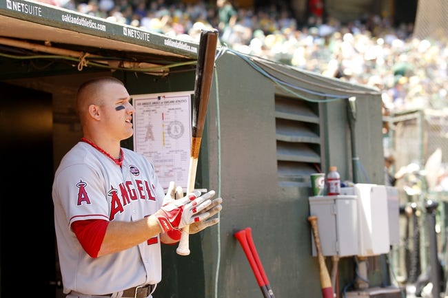 Jul 28, 2013; Oakland, CA, USA; Los Angeles Angels outfielder Mike Trout (27) stands in the dugout before the start of the game against the Oakland Athletics at O.co Coliseum. The Athletics defeated the Angels 10-6. Mandatory Credit: Cary Edmondson-USA TODAY Sports