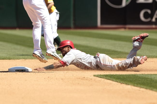 Jul 28, 2013; Oakland, CA, USA; Los Angeles Angels infielder Erick Aybar (2) steals second base against the Oakland Athletics in the second inning at O.co Coliseum. The Athletics defeated the Angels 10-6. Mandatory Credit: Cary Edmondson-USA TODAY Sports