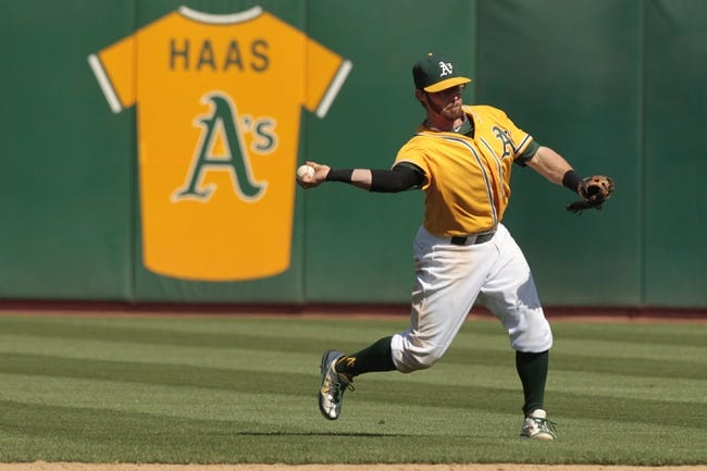 Jul 28, 2013; Oakland, CA, USA; Oakland Athletics infielder Eric Sogard (28) throws the ball to first to record an out against the Los Angeles Angels in the ninth inning at O.co Coliseum. The Athletics defeated the Angels 10-6. Mandatory Credit: Cary Edmondson-USA TODAY Sports