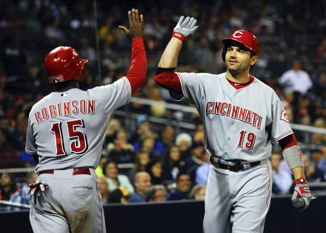 Jul 29, 2013; San Diego, CA, USA; Cincinnati Reds center fielder Derrick Robinson (15) is congratulated by first baseman Joey Votto (19) after scoring during the fifth inning against the San Diego Padres at Petco Park. . Mandatory Credit: Christopher Hanewinckel-USA TODAY Sports