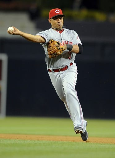 Jul 29, 2013; San Diego, CA, USA; Cincinnati Reds second baseman Cesar Izturis (3) throws the ball to first base for an out during the fifth inning against the San Diego Padres at Petco Park. . Mandatory Credit: Christopher Hanewinckel-USA TODAY Sports