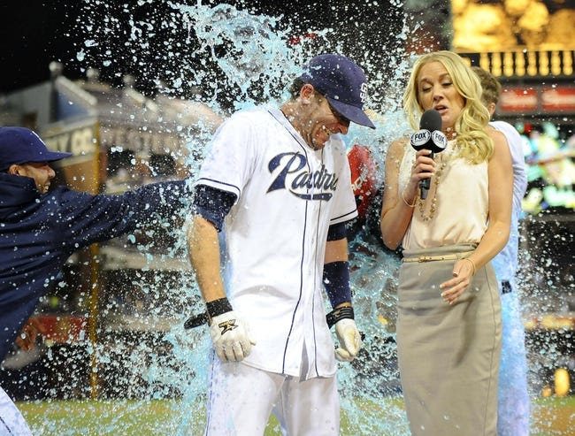 Jul 29, 2013; San Diego, CA, USA; San Diego Padres pinch hitter Chris Denorfia (13) is dumped with Powerade during a post-game interview with Fox Sports San Diego reporter Kelly Crull following a walk off two-run home run in the ninth inning inning against the Cincinnati Reds at Petco Park. . Mandatory Credit: Christopher Hanewinckel-USA TODAY Sports