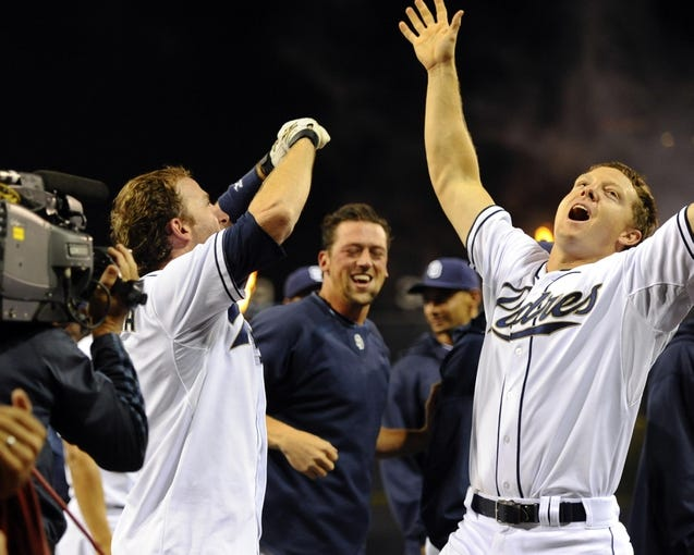 Jul 29, 2013; San Diego, CA, USA; San Diego Padres pinch hitter Chris Denorfia (13) celebrates with catcher Nick Hundley (right) after a game-winning two-run home run during the ninth inning against the Cincinnati Reds at Petco Park. Mandatory Credit: Christopher Hanewinckel-USA TODAY Sports