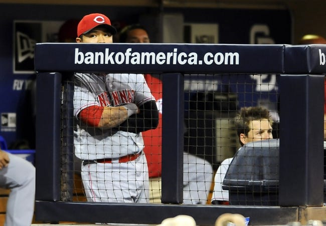 Jul 29, 2013; San Diego, CA, USA; Cincinnati Reds center fielder Shin-Soo Choo (17) looks on from the dugout during the ninth inning against the San Diego Padres at Petco Park. The Reds lost 2-1. Mandatory Credit: Christopher Hanewinckel-USA TODAY Sports
