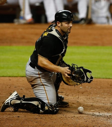 Jul 27, 2013; Miami, FL, USA;  Pittsburgh Pirates catcher Michael McKenry after blocking a pitch against the Miami Marlins at Marlins Park. The Pirates won 7-4. Mandatory Credit: Robert Mayer-USA TODAY Sports