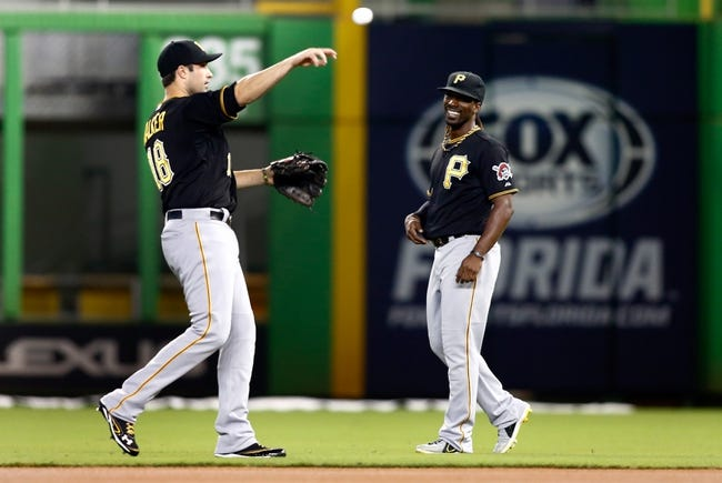 Jul 27, 2013; Miami, FL, USA;  Pittsburgh Pirates center fielder Andrew McCutchen (22) and  second baseman Neil Walker (18) before a game against the Miami Marlins at Marlins Park. Mandatory Credit: Robert Mayer-USA TODAY Sports