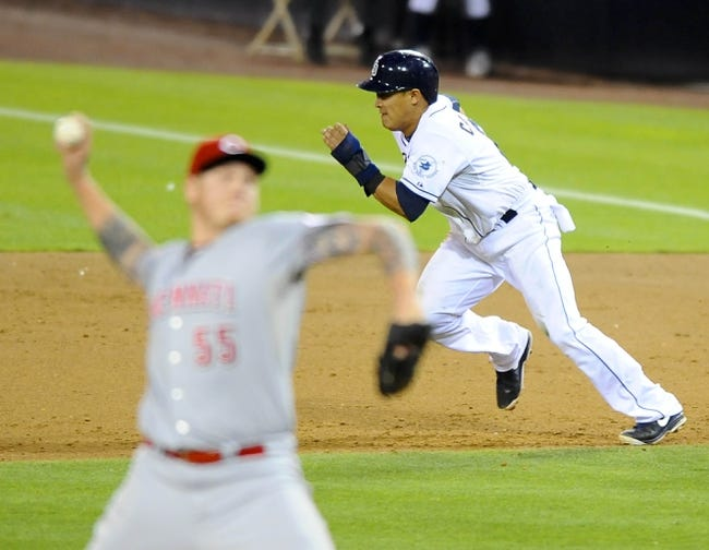 Jul 30, 2013; San Diego, CA, USA; San Diego Padres shortstop Everth Cabrera (2) steals second base on Cincinnati Reds starting pitcher Mat Latos (55) during the fifth inning at Petco Park. Mandatory Credit: Christopher Hanewinckel-USA TODAY Sports