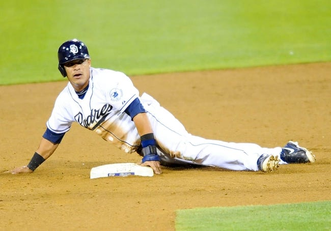 Jul 30, 2013; San Diego, CA, USA; San Diego Padres shortstop Everth Cabrera (2) steals second base on Cincinnati Reds starting pitcher Mat Latos (not pictured) during the fifth inning at Petco Park. Mandatory Credit: Christopher Hanewinckel-USA TODAY Sports