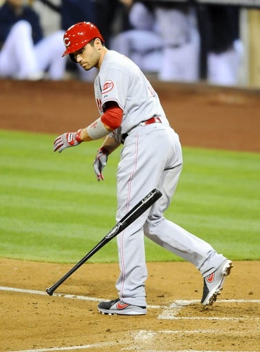 Jul 30, 2013; San Diego, CA, USA; Cincinnati Reds first baseman Joey Votto (19) tosses the bat after a walk in the sixth inning against the San Diego Padres at Petco Park. Mandatory Credit: Christopher Hanewinckel-USA TODAY Sports