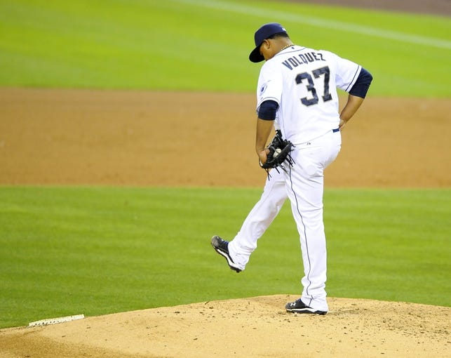 Jul 30, 2013; San Diego, CA, USA; San Diego Padres starting pitcher Edinson Volquez (37) kicks the mound after walking two battersin the sixth inning against the Cincinnati Reds at Petco Park. Mandatory Credit: Christopher Hanewinckel-USA TODAY Sports