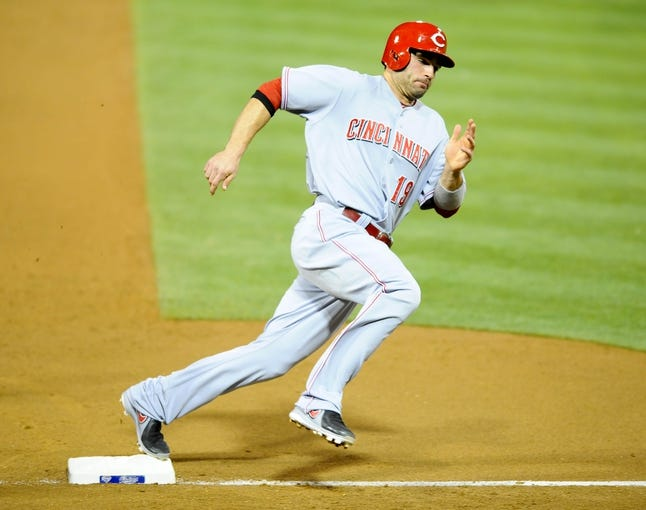 Jul 30, 2013; San Diego, CA, USA; Cincinnati Reds first baseman Joey Votto (19) rounds third base on his way to scoring in the sixth inning against the San Diego Padres at Petco Park. Mandatory Credit: Christopher Hanewinckel-USA TODAY Sports