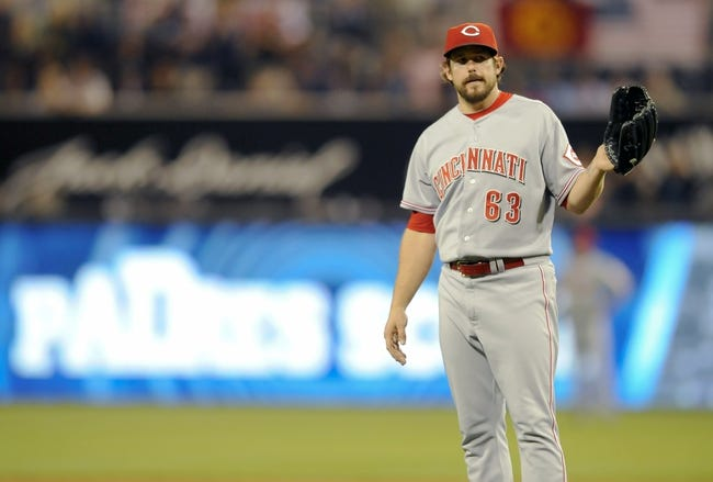 Jul 30, 2013; San Diego, CA, USA; Cincinnati Reds relief pitcher Sam LeCure (63) reacts after allowing a two-run double during the eighth inning against the San Diego Padres at Petco Park. Mandatory Credit: Christopher Hanewinckel-USA TODAY Sports