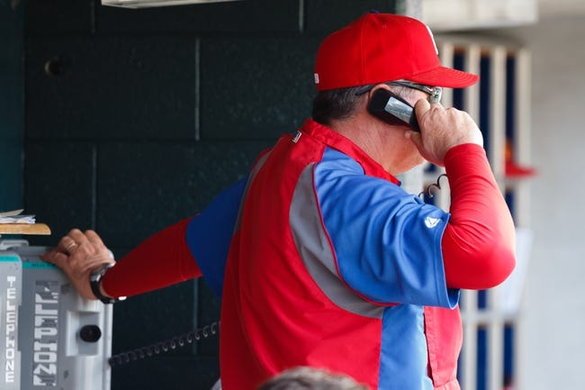 Jul 28, 2013; Detroit, MI, USA; Philadelphia Phillies pitching coach Rich Dubee (30) calls to the bullpen in the sixth inning against the Detroit Tigers at Comerica Park. Mandatory Credit: Rick Osentoski-USA TODAY Sports