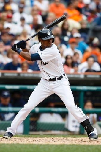 Jul 28, 2013; Detroit, MI, USA; Detroit Tigers center fielder Austin Jackson (14) at bat against the Philadelphia Phillies at Comerica Park. Mandatory Credit: Rick Osentoski-USA TODAY Sports