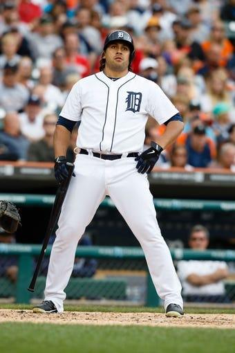 Jul 28, 2013; Detroit, MI, USA; Detroit Tigers left fielder Matt Tuiasosopo (18) reacts at bat against the Philadelphia Phillies at Comerica Park. Mandatory Credit: Rick Osentoski-USA TODAY Sports