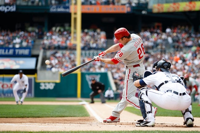 Jul 28, 2013; Detroit, MI, USA; Philadelphia Phillies second baseman Chase Utley (26) at bat in front of Detroit Tigers catcher Alex Avila (13) at Comerica Park. Mandatory Credit: Rick Osentoski-USA TODAY Sports
