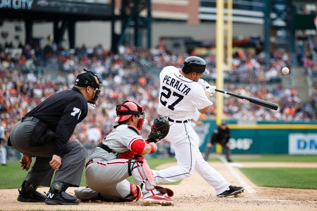 Jul 28, 2013; Detroit, MI, USA; Detroit Tigers shortstop Jhonny Peralta (27) at bat in front of Philadelphia Phillies catcher Carlos Ruiz (51) and umpire Chad Fairchild (75) at Comerica Park. Mandatory Credit: Rick Osentoski-USA TODAY Sports