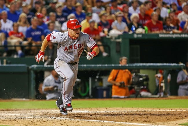 Jul 30, 2013; Arlington, TX, USA; Los Angeles Angels center fielder Mike Trout (27) runs to first during the game against the Texas Rangers at Rangers Ballpark in Arlington. Texas won 14-11.  Mandatory Credit: Kevin Jairaj-USA TODAY Sports