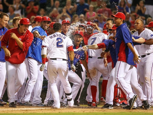 Jul 30, 2013; Arlington, TX, USA; Texas Rangers left fielder Leonys Martin (2) celebrates with teammates after hitting a home run during the game against the Los Angeles Angels at Rangers Ballpark in Arlington. Texas won 14-11.  Mandatory Credit: Kevin Jairaj-USA TODAY Sports