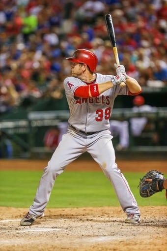 Jul 30, 2013; Arlington, TX, USA; Los Angeles Angels left fielder J.B. Shuck (39) bats during the game against the Texas Rangers at Rangers Ballpark in Arlington. Texas won 14-11.  Mandatory Credit: Kevin Jairaj-USA TODAY Sports
