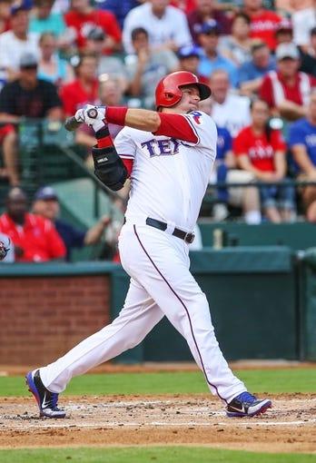 Jul 30, 2013; Arlington, TX, USA; Texas Rangers designated hitter A.J. Pierzynski (12) bats during the game against the Los Angeles Angels at Rangers Ballpark in Arlington. Texas won 14-11.  Mandatory Credit: Kevin Jairaj-USA TODAY Sports