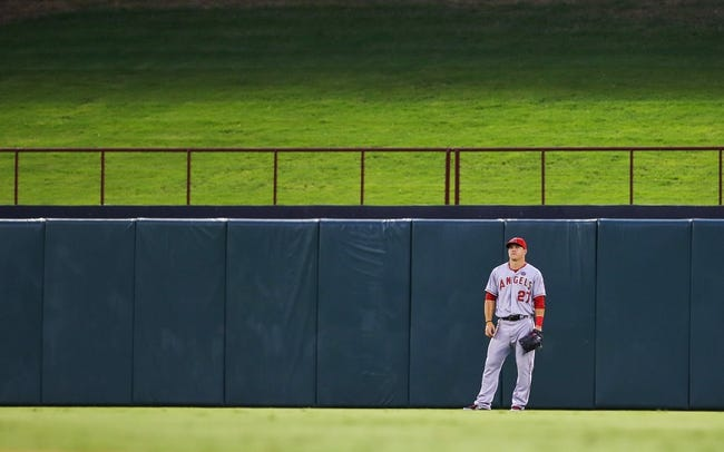 Jul 30, 2013; Arlington, TX, USA; Los Angeles Angels center fielder Mike Trout (27) plays defense during the game against the Texas Rangers at Rangers Ballpark in Arlington. Texas won 14-11.  Mandatory Credit: Kevin Jairaj-USA TODAY Sports