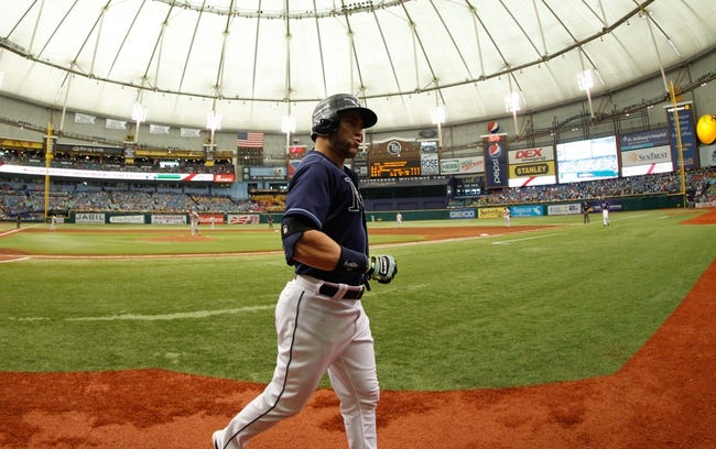 Jul 11, 2013; St. Petersburg, FL, USA; Tampa Bay Rays designated hitter Luke Scott (30) reacts after he scored against the Minnesota Twins at Tropicana Field. Tampa Bay Rays defeated the Minnesota Twins 4-3. Mandatory Credit: Kim Klement-USA TODAY Sports