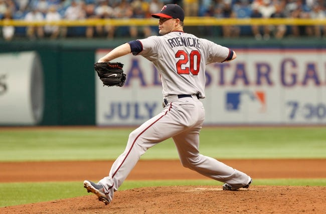 Jul 11, 2013; St. Petersburg, FL, USA; Minnesota Twins relief pitcher Josh Roenicke (20) throws a pitch against the Tampa Bay Rays at Tropicana Field. Tampa Bay Rays defeated the Minnesota Twins 4-3. Mandatory Credit: Kim Klement-USA TODAY Sports