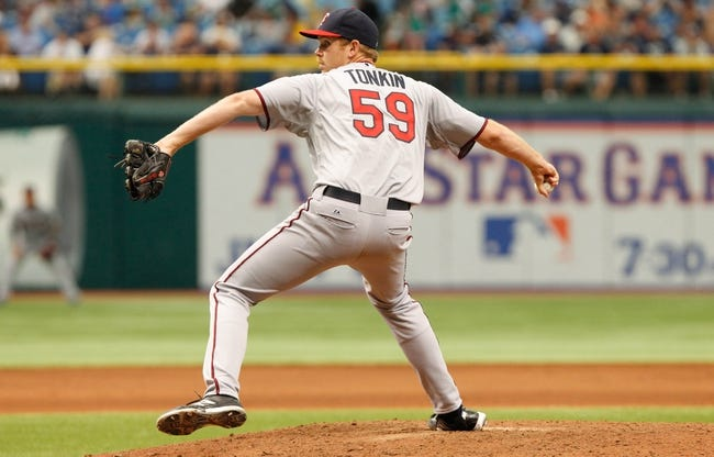 Jul 11, 2013; St. Petersburg, FL, USA; Minnesota Twins pitcher Michael Tonkin (59) throws a pitch against the Tampa Bay Rays at Tropicana Field. Tampa Bay Rays defeated the Minnesota Twins 4-3. Mandatory Credit: Kim Klement-USA TODAY Sports
