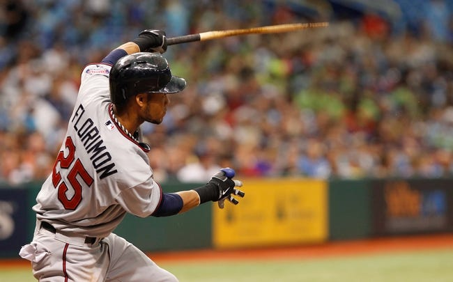 Jul 11, 2013; St. Petersburg, FL, USA; Minnesota Twins shortstop Pedro Florimon (25) hits a single as his bat breaks against the Tampa Bay Rays at Tropicana Field. Tampa Bay Rays defeated the Minnesota Twins 4-3. Mandatory Credit: Kim Klement-USA TODAY Sports