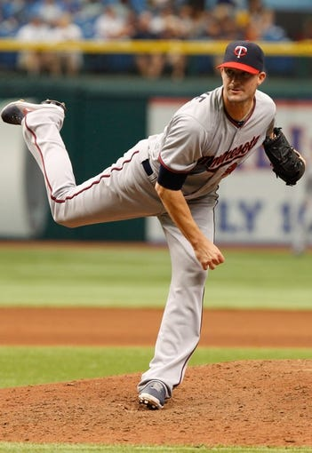 Jul 11, 2013; St. Petersburg, FL, USA; Minnesota Twins relief pitcher Josh Roenicke (20) against the Tampa Bay Rays at Tropicana Field. Tampa Bay Rays defeated the Minnesota Twins 4-3. Mandatory Credit: Kim Klement-USA TODAY Sports