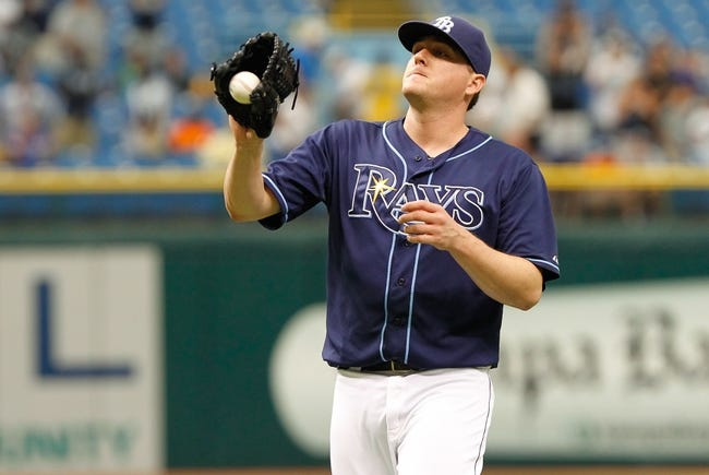 Jul 11, 2013; St. Petersburg, FL, USA; Tampa Bay Rays relief pitcher Jake McGee (57) catches the ball against the Minnesota Twins at Tropicana Field. Tampa Bay Rays defeated the Minnesota Twins 4-3. Mandatory Credit: Kim Klement-USA TODAY Sports