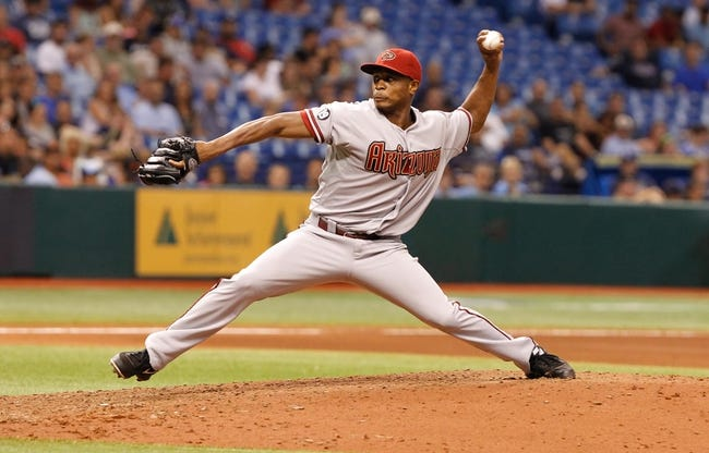 Jul 30, 2013; St. Petersburg, FL, USA; Arizona Diamondbacks relief pitcher Tony Sipp (49) throws a pitch during the seventh inning against the Tampa Bay Rays at Tropicana Field. Mandatory Credit: Kim Klement-USA TODAY Sports