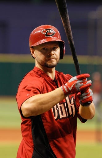 Jul 30, 2013; St. Petersburg, FL, USA; Arizona Diamondbacks right fielder Cody Ross (7) works out prior to the game against the Tampa Bay Rays at Tropicana Field. Mandatory Credit: Kim Klement-USA TODAY Sports