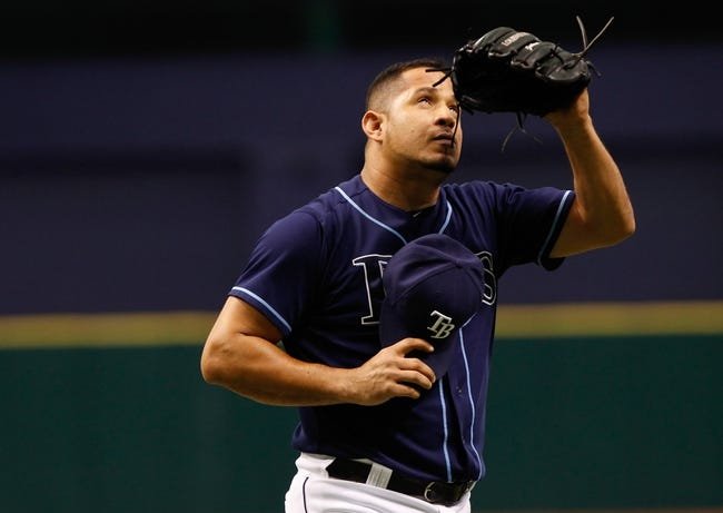 Jul 11, 2013; St. Petersburg, FL, USA; Tampa Bay Rays relief pitcher Joel Peralta (62) reacts after he pitches against the Minnesota Twins at Tropicana Field. Tampa Bay Rays defeated the Minnesota Twins 4-3. Mandatory Credit: Kim Klement-USA TODAY Sports