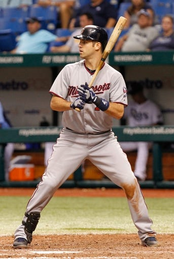 Jul 10, 2013; St. Petersburg, FL, USA; Minnesota Twins catcher Joe Mauer (7) at bat against the Tampa Bay Rays at Tropicana Field. Tampa Bay Rays defeated the Minnesota Twins 4-3 in thirteen inning. Mandatory Credit: Kim Klement-USA TODAY Sports