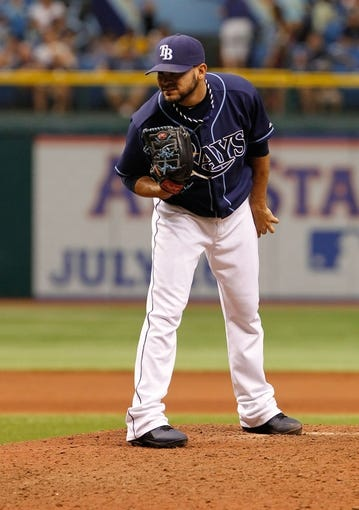 Jul 11, 2013; St. Petersburg, FL, USA; Tampa Bay Rays relief pitcher Alex Torres (54) throws a pitch against the Minnesota Twins at Tropicana Field. Tampa Bay Rays defeated the Minnesota Twins 4-3. Mandatory Credit: Kim Klement-USA TODAY Sports