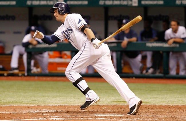 Jul 10, 2013; St. Petersburg, FL, USA; Tampa Bay Rays third baseman Evan Longoria (3) singles against the Minnesota Twins at Tropicana Field. Tampa Bay Rays defeated the Minnesota Twins 4-3 in thirteen inning. Mandatory Credit: Kim Klement-USA TODAY Sports
