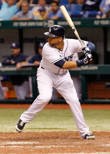 Jul 10, 2013; St. Petersburg, FL, USA; Tampa Bay Rays first baseman James Loney (21) at bat against the Minnesota Twins at Tropicana Field. Tampa Bay Rays defeated the Minnesota Twins 4-3 in thirteen inning. Mandatory Credit: Kim Klement-USA TODAY Sports