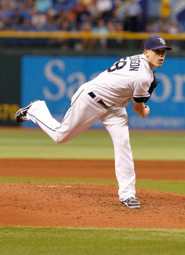 Jul 10, 2013; St. Petersburg, FL, USA; Tampa Bay Rays starting pitcher Jeremy Hellickson (58) throws a pitch against the Minnesota Twins at Tropicana Field. Mandatory Credit: Kim Klement-USA TODAY Sports