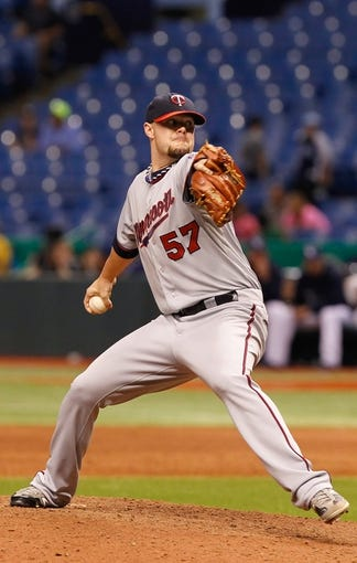 Jul 10, 2013; St. Petersburg, FL, USA; Minnesota Twins relief pitcher Ryan Pressly (57) throws a pitch during the thirteenth inning against the Tampa Bay Rays at Tropicana Field. Tampa Bay Rays defeated the Minnesota Twins 4-3 in thirteen inning. Mandatory Credit: Kim Klement-USA TODAY Sports