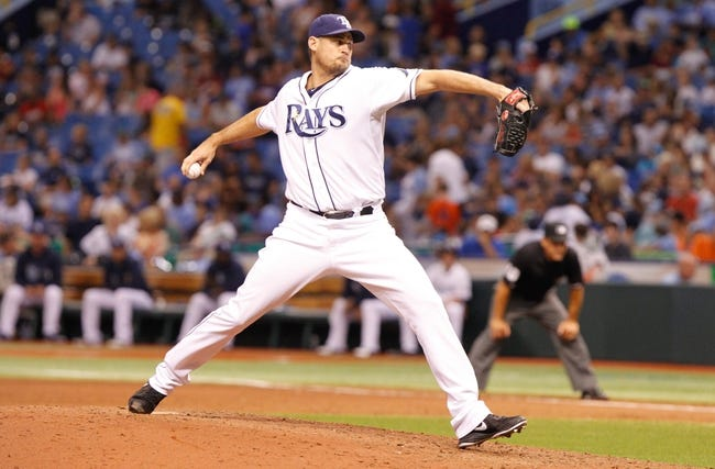 Jul 31, 2013; St. Petersburg, FL, USA; Tampa Bay Rays relief pitcher Jamey Wright (35) throws a pitch against the Arizona Diamondbacks at Tropicana Field. Arizona Diamondbacks defeated the Tampa Bay Rays 7-0. Mandatory Credit: Kim Klement-USA TODAY Sports