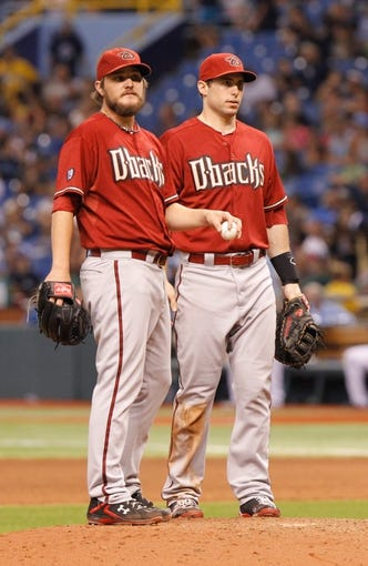 Jul 31, 2013; St. Petersburg, FL, USA; Arizona Diamondbacks starting pitcher Wade Miley (36) and first baseman Paul Goldschmidt (44) on the mound against the Tampa Bay Rays at Tropicana Field. Arizona Diamondbacks defeated the Tampa Bay Rays 7-0. Mandatory Credit: Kim Klement-USA TODAY Sports