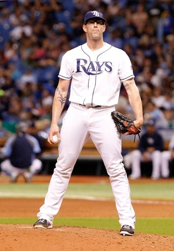Jul 31, 2013; St. Petersburg, FL, USA; Tampa Bay Rays relief pitcher Kyle Farnsworth (43) gets ready to throw a pitch against the Arizona Diamondbacks at Tropicana Field. Arizona Diamondbacks defeated the Tampa Bay Rays 7-0. Mandatory Credit: Kim Klement-USA TODAY Sports