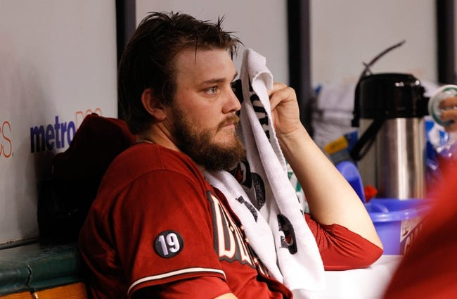 Jul 31, 2013; St. Petersburg, FL, USA; Arizona Diamondbacks starting pitcher Wade Miley (36) in the dugout against the Tampa Bay Rays at Tropicana Field. Mandatory Credit: Kim Klement-USA TODAY Sports