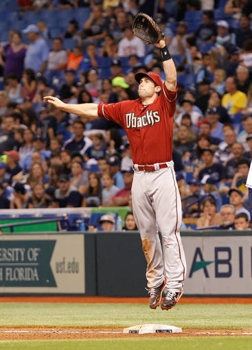 Jul 31, 2013; St. Petersburg, FL, USA; Arizona Diamondbacks first baseman Paul Goldschmidt (44) jumps up to catch the ball against the Tampa Bay Rays at Tropicana Field. Arizona Diamondbacks defeated the Tampa Bay Rays 7-0. Mandatory Credit: Kim Klement-USA TODAY Sports