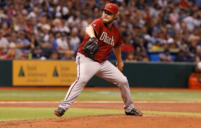 Jul 31, 2013; St. Petersburg, FL, USA; Arizona Diamondbacks starting pitcher Wade Miley (36) throws a pitch against the Tampa Bay Rays at Tropicana Field. Mandatory Credit: Kim Klement-USA TODAY Sports